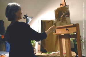 Sherrie McGraw painting a still life
