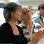 Sherrie gives pointers to a workshop participant.