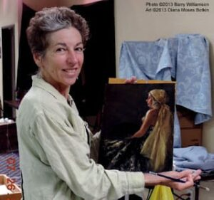 Diana Moses Boskins with her painting from the workshop