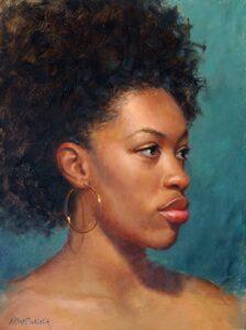 Dark skinned woman with hooped earrings